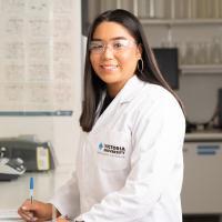 Stella Rose Lay in a VU lab coat in a lab
