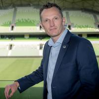 Trent Jacobs standing inside an empty AAMI park